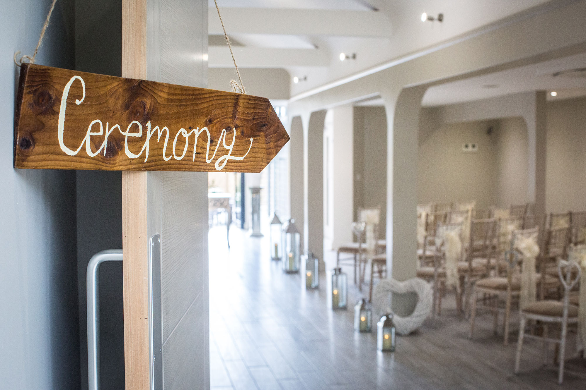 A wooden sign pointing to the spectacular wedding room ready for a Civil Ceremony at All Saints Hotel