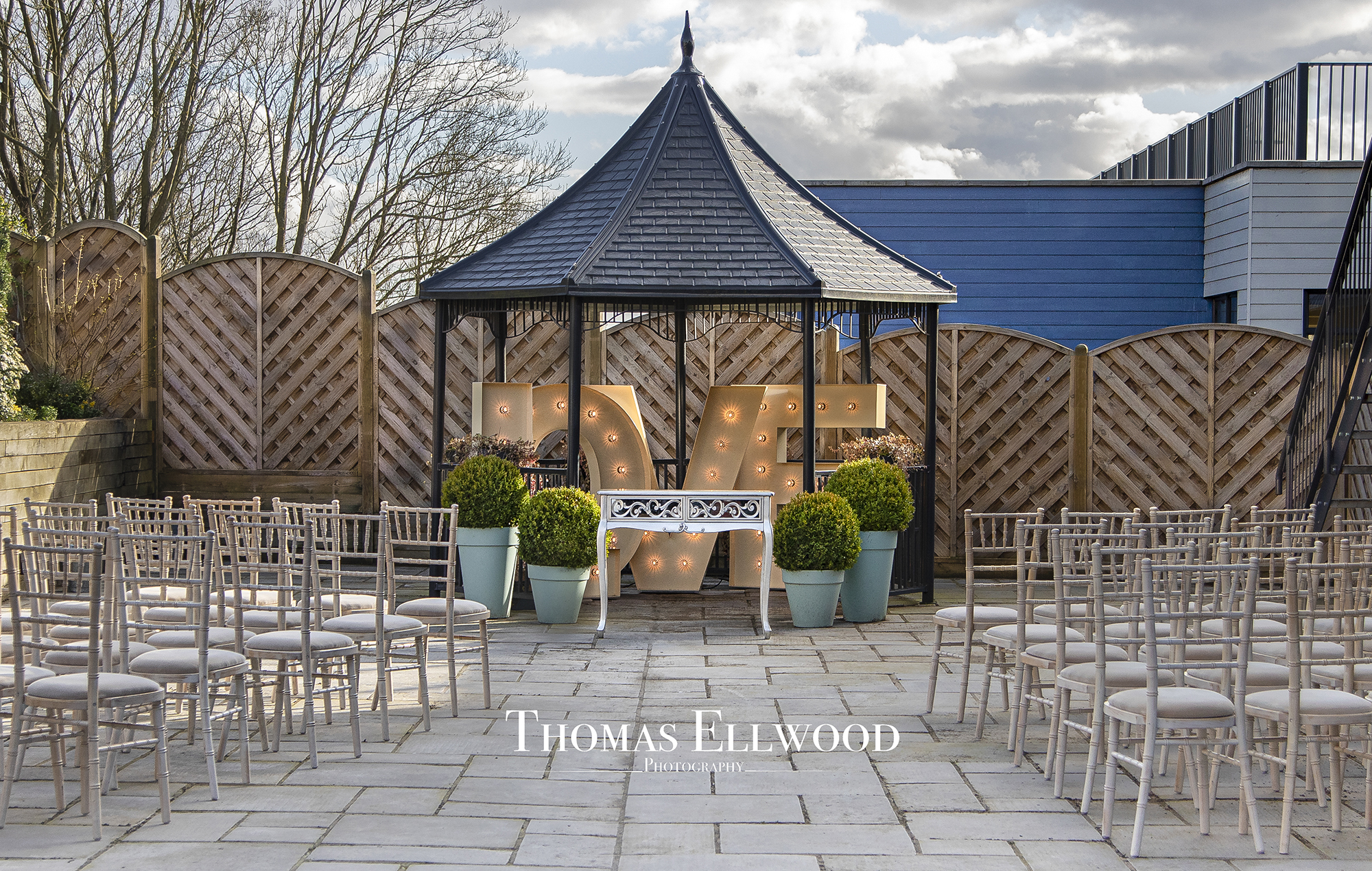 An outdoor Pavilion and seating area ready for a Civil Marriage Ceremony at All Saints Hotel, Suffolk, UK