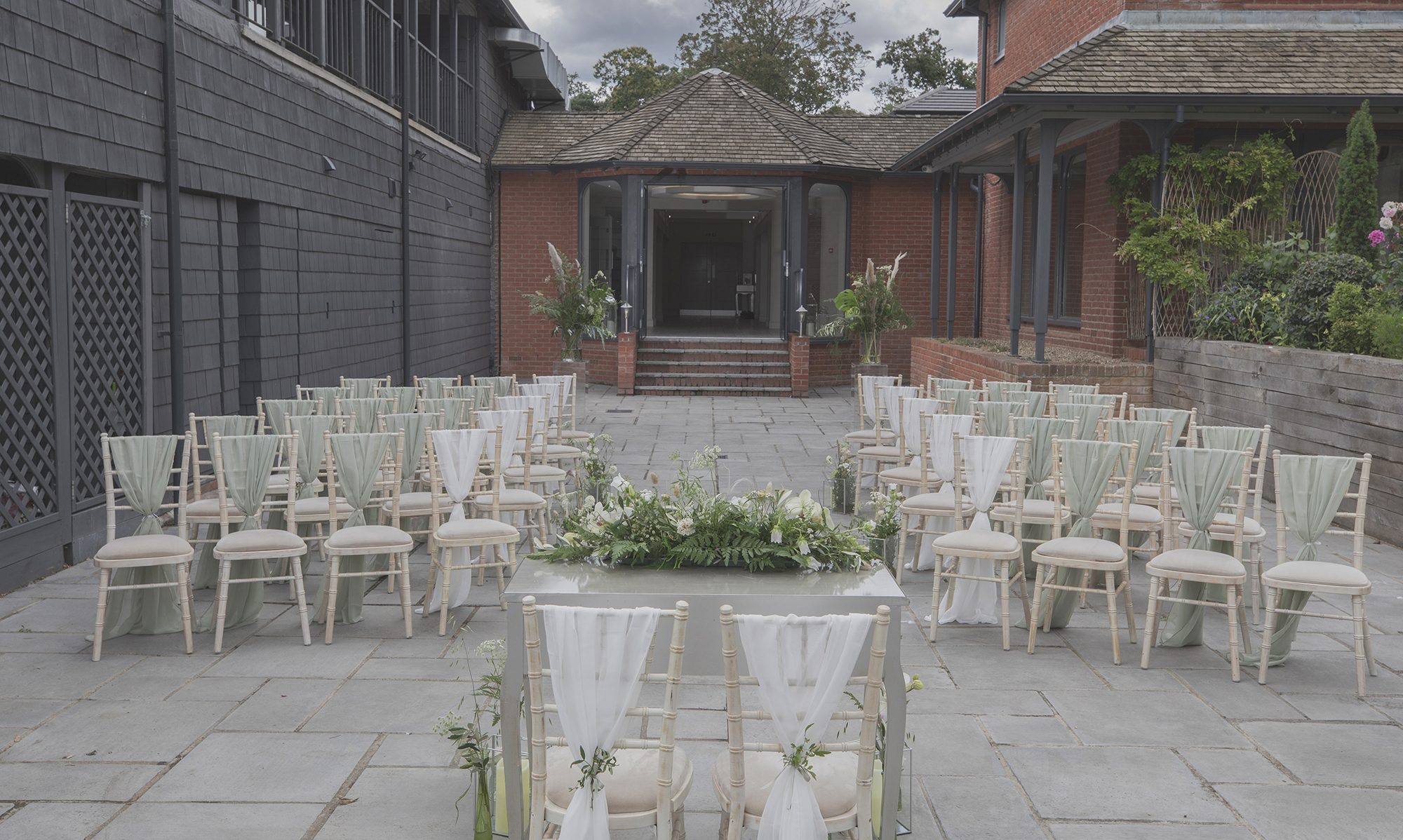 A wonderfully laid outdoor seating area ready for a Civil Marriage Ceremony at All Saints Hotel, Bury St Edmunds