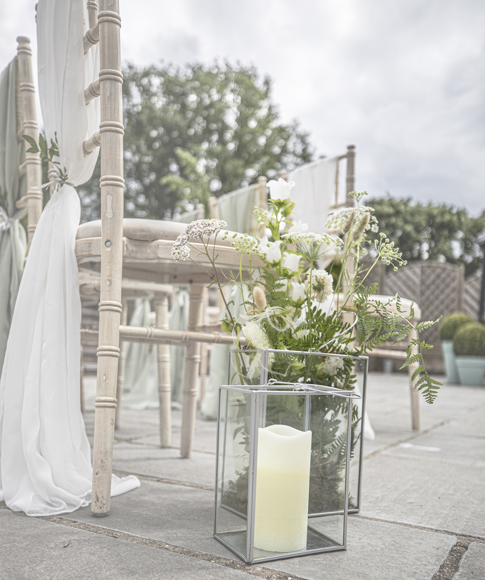 A candle and flowers ready for a marriage at All Saints Hotel, Bury St Edmunds