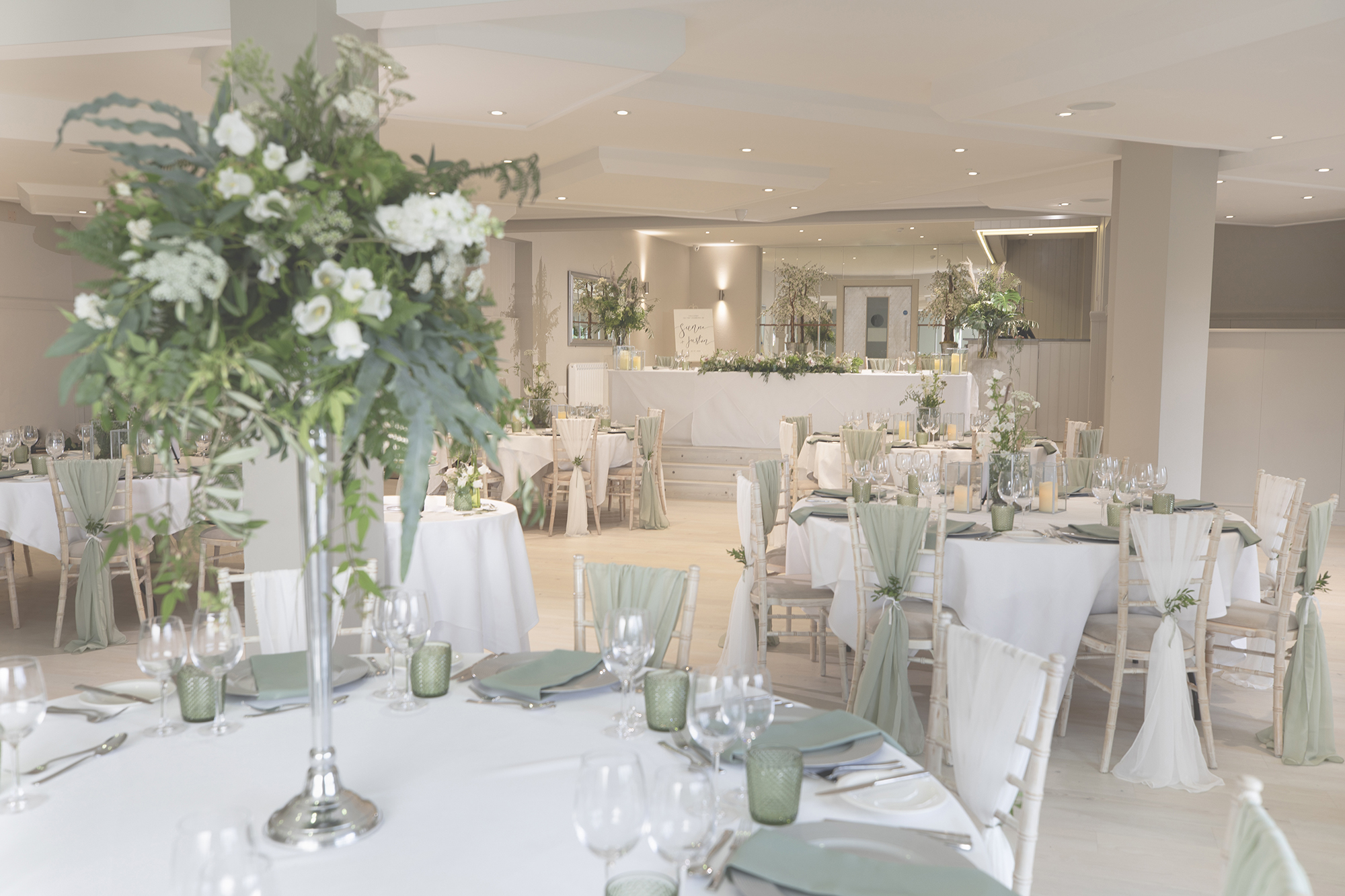 Beautiful laid tables and flowers ready for the wedding breakfast, in the main function room at All Saints Hotel