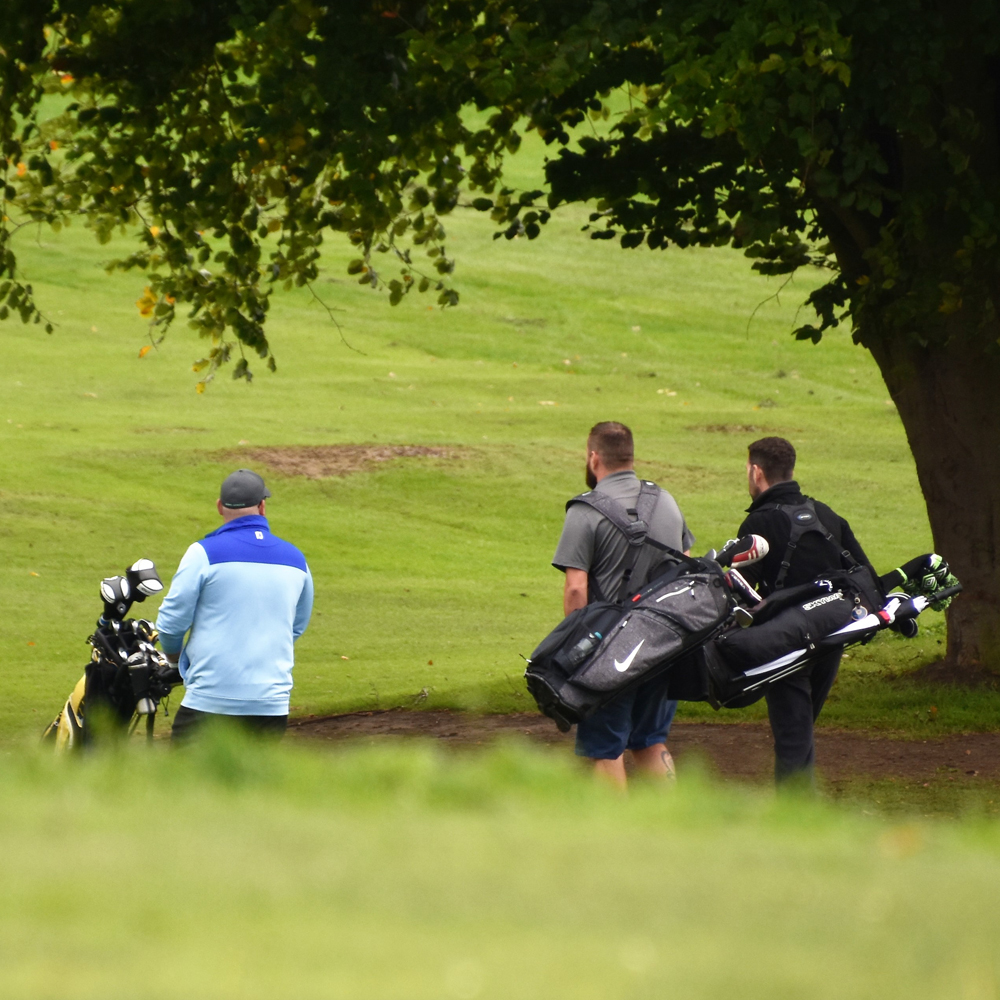 Walking to the next tee at The Suffolk Golf Course, at All Saints Hotel in Suffolk